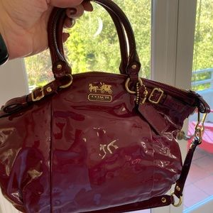 Coach red nylon handbag and crossbody. Gold trim